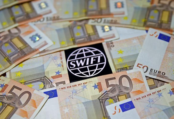 Swift code bank logo is displayed on an iPhone 6s among Euro banknotes in this picture illustration January 26, 2016.  REUTERS/Dado Ruvic/File Photo