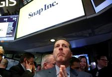 Specialist Trader Glen Carell gives a price for Snap Inc. during the company's IPO on the floor of the New York Stock Exchange (NYSE) in New York, U.S., March 2, 2017. REUTERS/Brendan McDermid