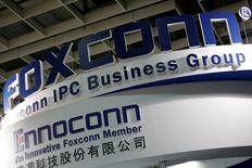 FILE PHOTO: Logos of Foxconn and Ennoconn are seen during the annual Computex computer exhibition in Taipei, Taiwan June 1, 2016. REUTERS/Tyrone Siu/File Photo