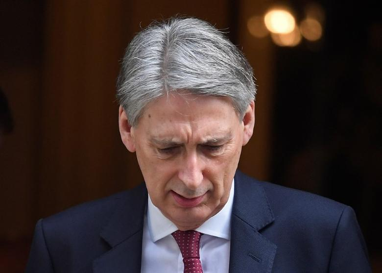 Britain's Chancellor of the Exchequer Philip Hammond leaves his official residence in Downing Street in London, Britain, March 7, 2017. REUTERS/Toby Melville/Files