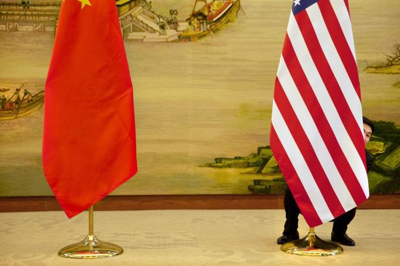 FILE PHOTO: A U.S. flag is tweaked ahead of a news conference between U.S. Secretary of State John Kerry and Chinese Foreign Minister Wang Yi at the Ministry of Foreign Affairs in Beijing, Wednesday, Jan. 27, 2016. REUTERS/Jacquelyn Martin/Pool
