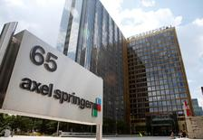 L'éditeur allemand Axel Springer a publié un bénéfice brut pour 2016 supérieur aux attentes, dopé par ses activités numériques, notamment ses annonces classées en ligne. /Photo d'archives/REUTERS/Fabrizio Bensch