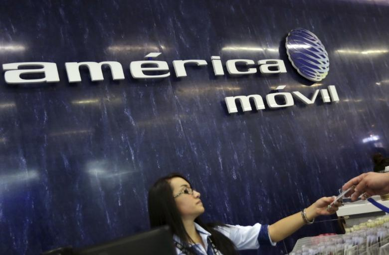 The America Movil logo is seen on the wall of the reception area in the company's corporate offices in Mexico City August 12, 2015.  REUTERS/Henry Romero