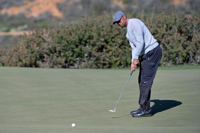 Jan 27, 2017; La Jolla, CA, USA; Tiger Woods putts on the 12th green during the second round of the Farmers Insurance Open golf tournament at Torrey Pines Municipal Golf Course - North Co. Mandatory Credit: Orlando Ramirez-USA TODAY Sports - RTSXPXY
