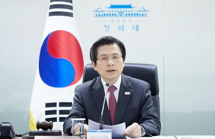South Korea's Prime Minister and acting President Hwang Kyo-ahn speaks during the National Security Council at the Presidential Blue House in Seoul, South Korea, in this handout picture provided by the Presidential Blue House and released by Yonhap on March 6, 2017.    The Presidential Blue House/Yonhap via REUTERS