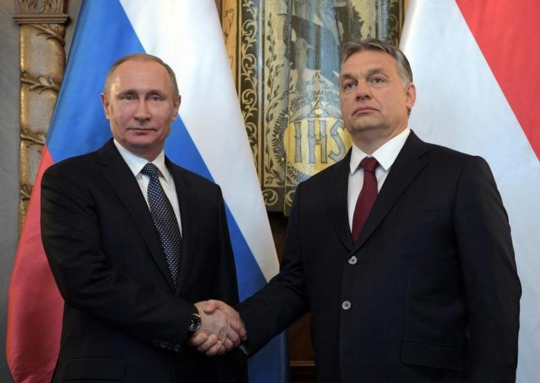 Russian President Vladimir Putin (L) shakes hands with Hungarian Prime Minister Viktor Orban during a meeting in Budapest, Hungary, February 2, 2017. Sputnik/Alexei Druzhinin/Kremlin via REUTERS