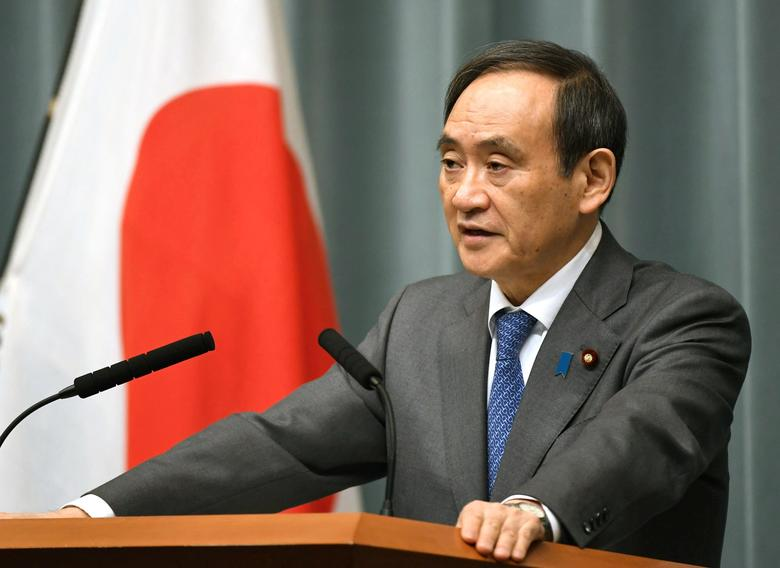 Japan's Chief Cabinet Secretary Yoshihide Suga speaks to media during a news conference in this photo taken by Kyodo February 12, 2017.  Mandatory credit Kyodo/via REUTERS