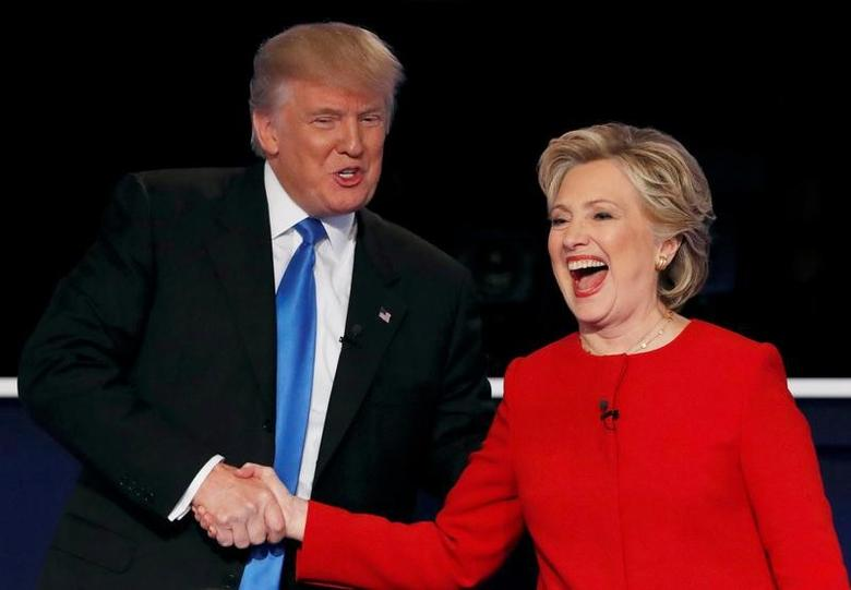 Donald Trump shakes hands with Hillary Clinton at the conclusion of their first presidential debate. REUTERS/Mike Segar