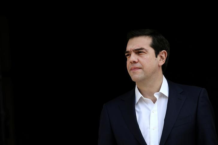Greek Prime Minister Alexis Tsipras waits to welcome his Maltese counterpart Joseph Muscat at the Maximos Mansion in Athens, Greece March 1, 2017. REUTERS/Alkis Konstantinidis