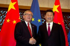 FILE PHOTO: European Commission President Jean-Claude Juncker, left and Chinese President Xi Jinping shake hands before a meeting held at the Diaoyutai State Guesthouse in Beijing, China, Tuesday, July 12, 2016. REUTERS/Ng Han Guan/File Photo