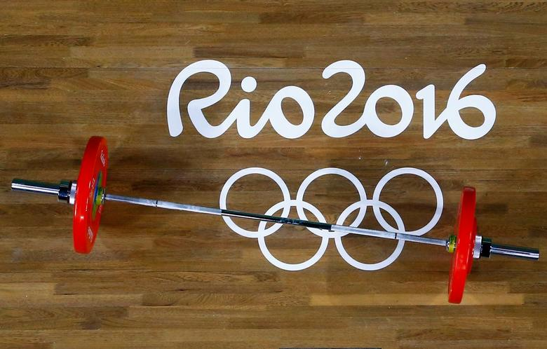 FILE PHOTO:  2016 Rio Olympics - Weightlifting - Final - Women's 48kg - Riocentro - Pavilion 2 - Rio de Janeiro, Brazil - 06/08/2016. Weights are prepared for the weightlifting competition. REUTERS/Stoyan Nenov/File Photo