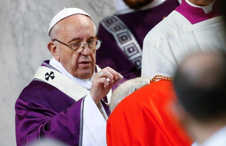 Pope Francis puts ashes on a cardinal's head during the Ash Wednesday mass at Santa Sabina Basilica in Rome, Italy March 1, 2017. REUTERS/Tony Gentile