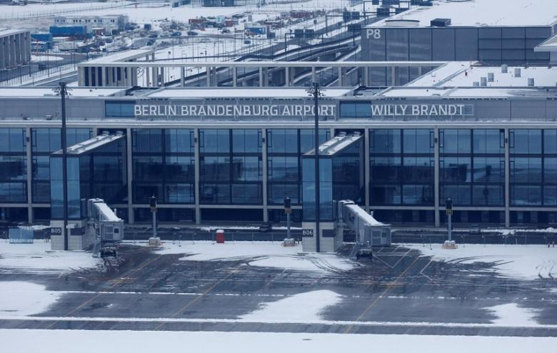 FILE PHOTO: A general view shows the main terminal of the construction site of Berlin Brandenburg international airport Willy Brandt (BER) in Schoenefeld, Germany, March 20, 2013. REUTERS/Tobias Schwarz/File Photo