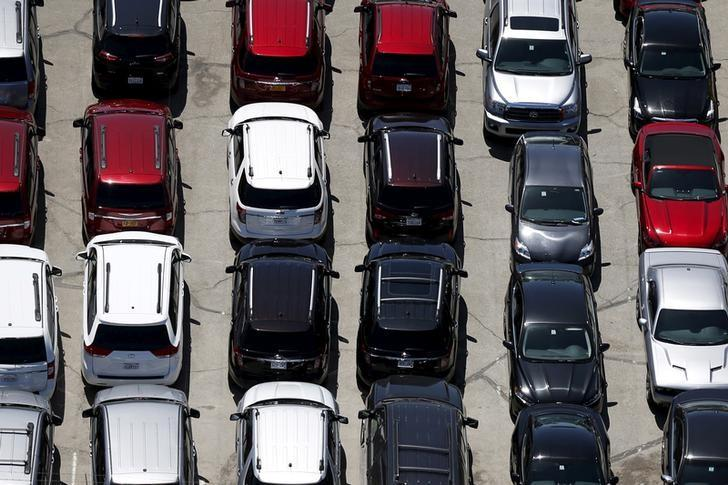 FILE PHOTO - Cars are seen in a parking lot in Palm Springs, California April 13, 2015. Picture taken April 13, 2015.  REUTERS/Lucy Nicholson/File Photo