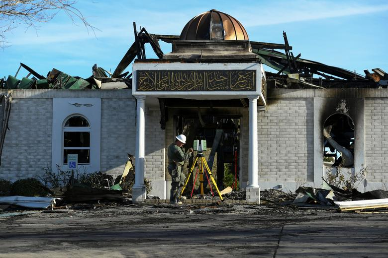 FILE PHOTO - A security official investigates the aftermath of a fire at the Victoria Islamic Center mosque in Victoria, Texas, U.S. on January 29, 2017.  REUTERS/Mohammad Khursheed/File Photo