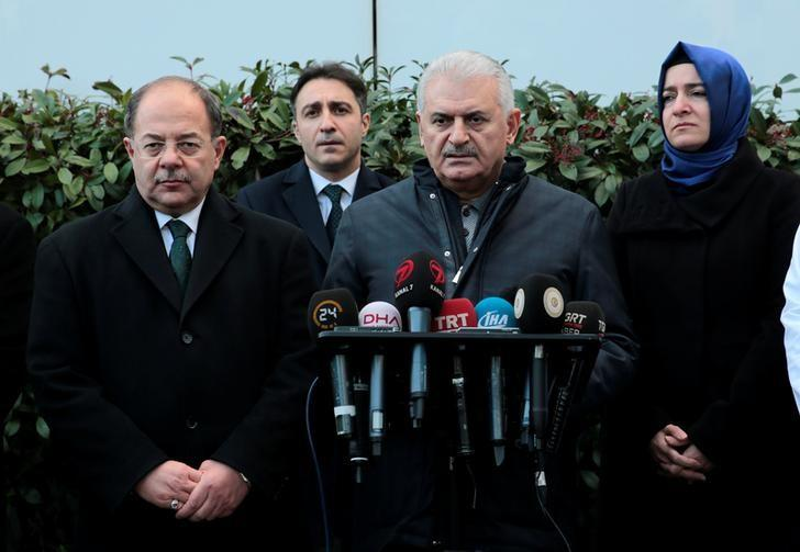 Turkish Prime Minister Binali Yildirim, accompanied by Health Minister Recep Akdag (L) and Minister of Family and Social Policies Fatma Betul Sayan Kaya (R), talks to media after he visited survivors of the nightclub attack at a hospital in Istanbul, Turkey, January 1, 2017. Ali Balikci/Prime Minister's Press Office/Handout via REUTERS