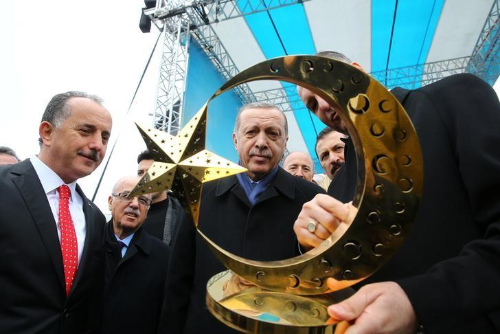 Turkish President Tayyip Erdogan receives a present during a ceremony in Istanbul, Turkey, March 11, 2017. Kayhan Ozer/Presidential Palace/Handout via REUTERS