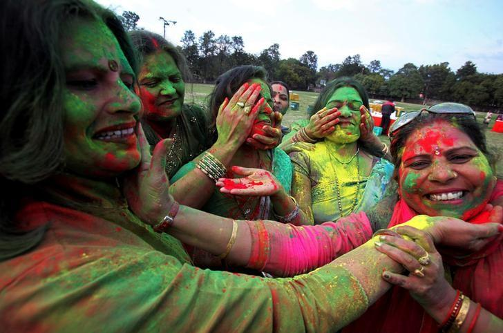 Women smear each other's faces with colours during the celebrations of Holi, the festival of colours, in Chandigarh, India, March 12,  2017. REUTERS/Ajay Verma