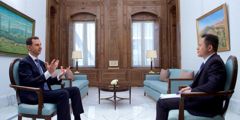 Syria's President Bashar al-Assad speaks during an interview with Chinese TV station Phoenix in Damascus, Syria, in this handout picture provided by SANA on March 11, 2017. SANA/Handout via REUTERS