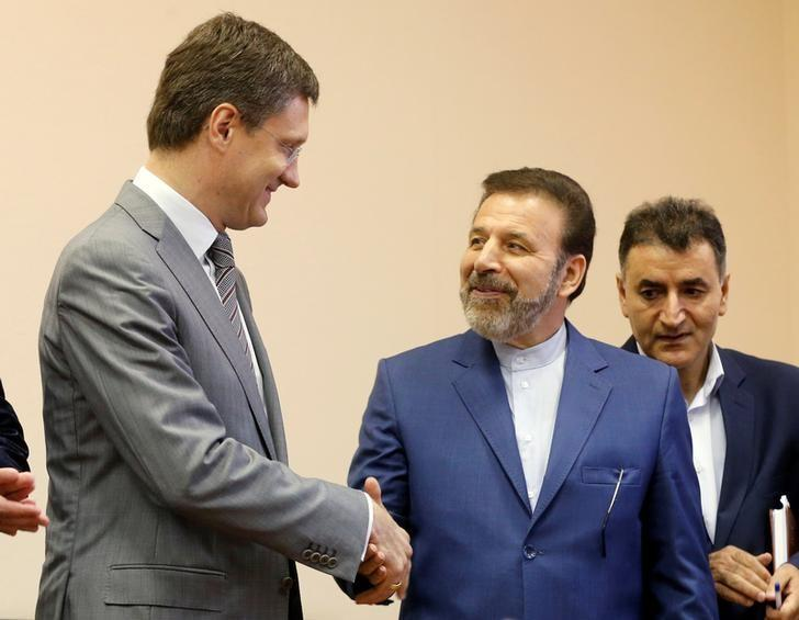 Russian Energy Minister Alexander Novak shakes hands with Iranian Communications Minister Mahmoud Vaezi during a signing ceremony after their meeting in Moscow, Russia, July 29, 2016.  REUTERS/Maxim Zmeyev