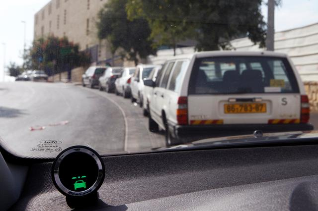 FILE PHOTO: A device, part of the Mobileye driving assist system, is seen on the dashboard of a vehicle during a demonstration for the media in Jerusalem October 24, 2012.  REUTERS/Baz Ratner/File Photo