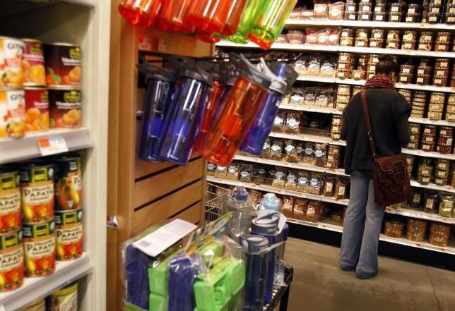 A woman shops for groceries at a Whole Foods supermarket in New York May 18, 2010. REUTERS/Shannon Stapleton