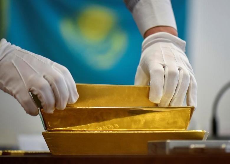 An employee places gold bars in the Kazakhstan's National Bank vault in Almaty, Kazakhstan, September 30, 2016.  REUTERS/Mariya Gordeyeva