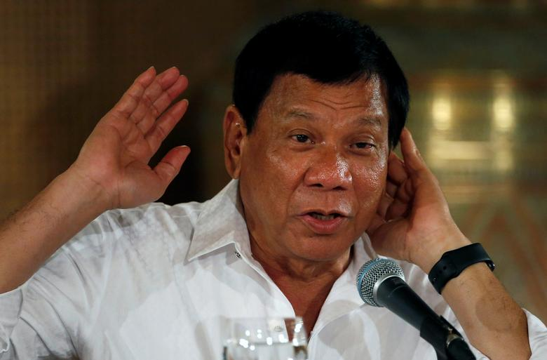 Philippine President Rodrigo Duterte speaks during a news conference at the presidential palace in Manila, Philippines March 13, 2017. Picture taken March 13, 2017. REUTERS/Erik De Castro
