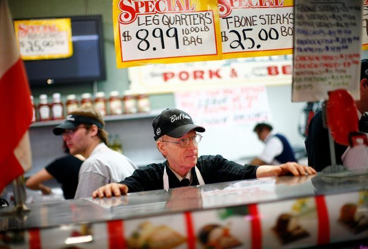 A worker waits for customers at a meat counter in the Broadway Market in Buffalo, New York April 10, 2011.  REUTERS/Eric Thayer/File Photo