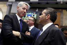 FILE PHOTO - William Ackman (L), chief executive of Pershing Square Capital, speaks with David Weinreb, CEO of Howard Hughes Corp. on the floor of the New York Stock Exchangein New York, U.S. on November 10, 2015. REUTERS/Brendan McDermid/File Photo