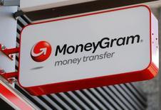 A Moneygram logo is seen outside a bank in Vienna, Austria, June 28, 2016. REUTERS/Heinz-Peter Bader