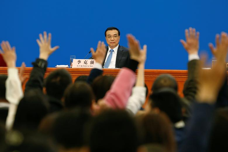China's Premier Li Keqiang looks as reporters raise hands during a news conference after the closing ceremony of China's National People's Congress (NPC) at the Great Hall of the People in Beijing, China, March 15, 2017. REUTERS/Thomas Peter
