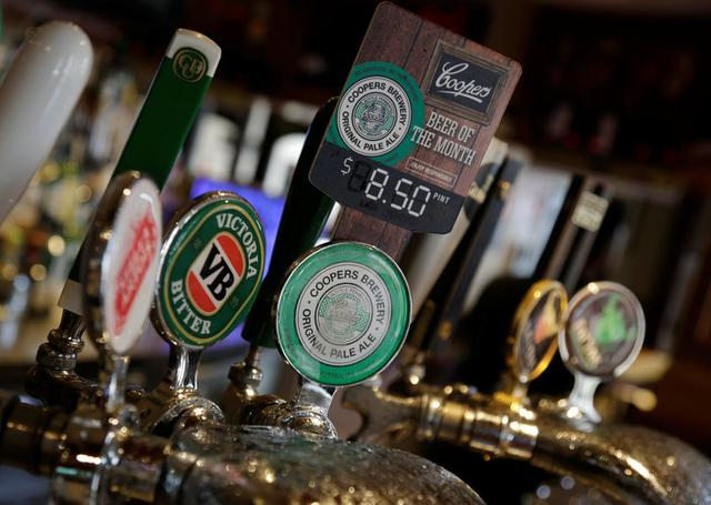 A beer tap features Australian-made Coopers Brewery pale ale as the beer of the month at The Rocks district of Sydney, Australia, March 15, 2017.   REUTERS/Jason Reed