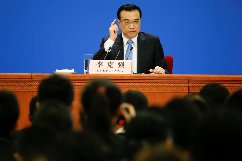 China's Premier Li Keqiang gestures during a news conference after the closing ceremony of China's National People's Congress (NPC) at the Great Hall of the People in Beijing, China, March 15, 2017. REUTERS/Jason Lee