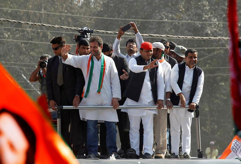 FILE PHOTO: Rahul Gandhi (L), Vice-President of India's main opposition Congress Party, and Akhilesh Yadav, Samajwadi Party (SP) President and Chief Minister of the northern state of Uttar Pradesh, wave to the crowd during a road show ahead of the fourth phase of state assembly polls, in Allahabad, India February 21, 2017. REUTERS/Jitendra Prakash/File photo