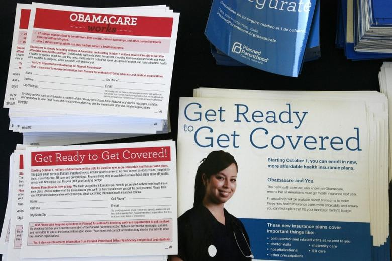 Information cards are stacked on a table during an Affordable Care Act outreach event for the Latino community in Los Angeles, California September 28, 2013. REUTERS/Jonathan Alcorn/Files