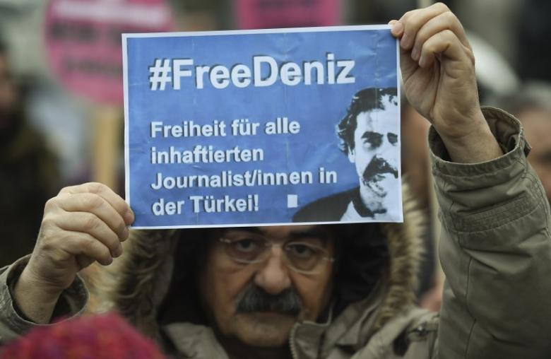 A protester demands the release of jailed Turkish-German journalist Deniz Yucel in Hamburg, Germany March 7, 2017. REUTERS/Fabian Bimmer