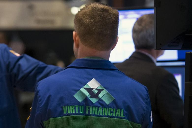 A Specialist trader for Virtu Financial works at a booth on the floor of the New York Stock Exchange April 16, 2015.  REUTERS/Brendan McDermid