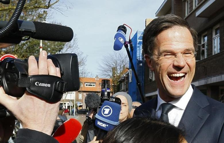 Dutch Prime Minister Mark Rutte of the VVD party greets supporters after voting  in the general election in The Hague, Netherlands, March 15, 2017.     REUTERS/Michael Kooren