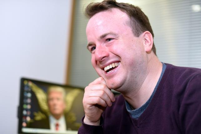 FILE PHOTO: Matt Forde talks about his TV show ''Unspun'' in an interview at Reuters' office in Canary Wharf, London, Britain March 1, 2017. REUTERS/Andrew Heavens/File Photo
