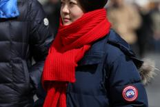 A woman wears a Canada Goose jacket at Times Square in New York, U.S., March 16, 2017. REUTERS/Shannon Stapleton