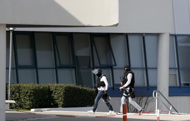 Police inside the Tocqueville high school after a shooting took place injuring at least eight people, in Grasse, southern France, March 16, 2017.    REUTERS/Eric Gaillard