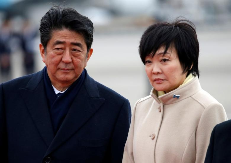 FILE PHOTO: Japan's Prime Minister Shinzo Abe (L) and his wife Akie send off Emperor Akihito and Empress Michiko boarding a special flight for their visit to Vietnam and Thailand, at Haneda Airport in Tokyo, Japan February 28, 2017. REUTERS/Issei Kato/File Photo