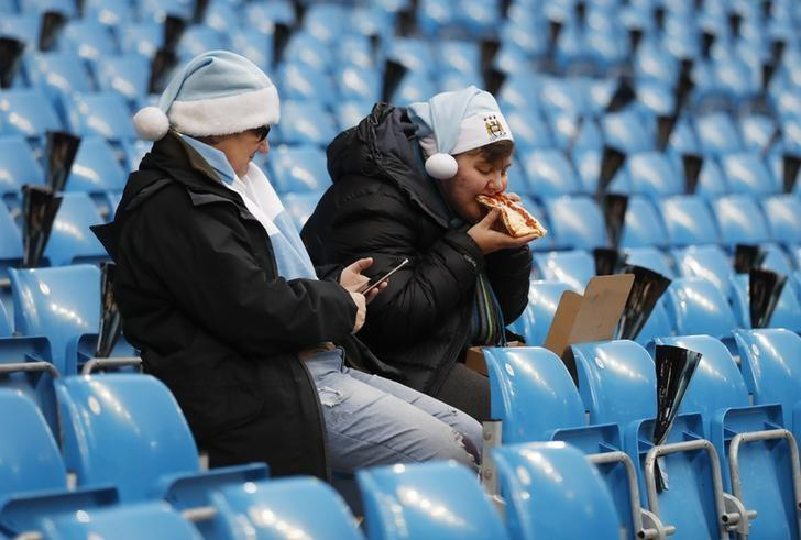 Britain Football Soccer - Manchester City v Arsenal - Premier League - Etihad Stadium - 18/12/16 Manchester City fans before the match  Action Images via Reuters / Carl Recine Livepic/File Photo