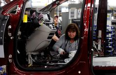 An FCA assembly worker works on the production line of the 2017 Chrysler Pacifica minivan at the FCA Windsor Assembly plant in Windsor, Ontario, May 6, 2016. REUTERS/Rebecca Cook