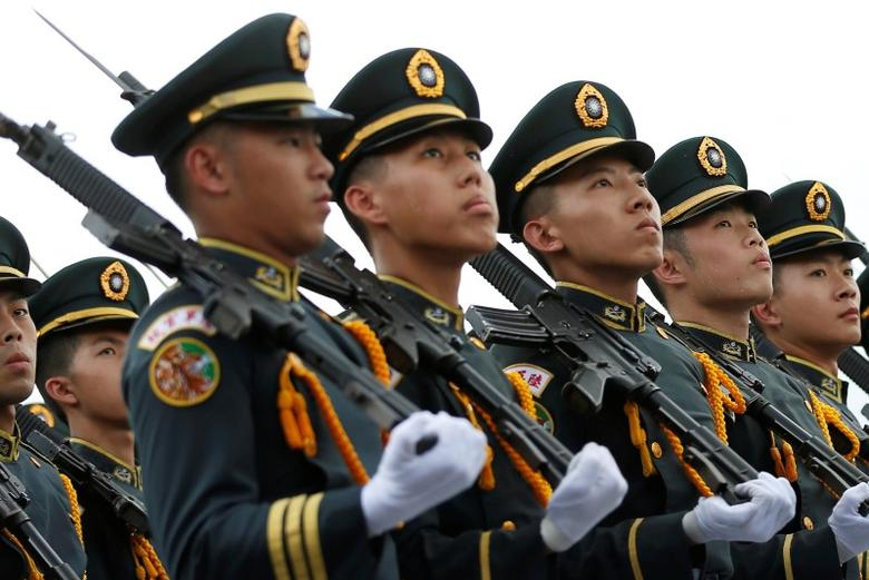 Taiwanese cadets march during a ceremony to mark the 92nd anniversary of the Whampoa Military Academy, in Kaohsiung, southern Taiwan June 16, 2016. REUTERS/Tyrone Siu