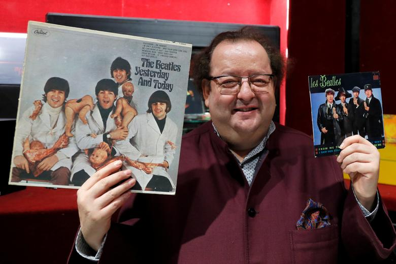 French Beatles specialist and collector Jacques Volcouve, one of the world's greatest living experts of the band, poses with the '' Yesterday And today '' and ''From Me To You'' covers at Drouot auction house in Paris, March 16, 2017, a part of the 15,000 items going on sale on next March 18. REUTERS/Charles Platiau