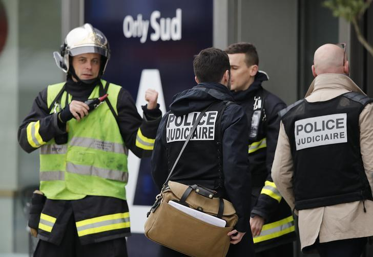 Judicial police investigators enter Orly airport southern terminal after a shooting incident near Paris, France March 18, 2017.  REUTERS/Benoit Tessier