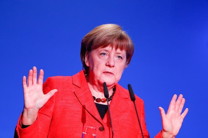 FILE PHOTO: German Chancellor Angela Merkel gives a speech at the demographic summit in Berlin, Germany, March 16, 2017.     REUTERS/Fabrizio Bensch/File Photo