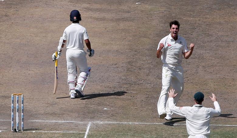 Cricket - India v Australia - Third Test cricket match - Jharkhand State Cricket Association Stadium, Ranchi, India - 18/03/17 - Australia's Pat Cummins celebrates after dismissing India's Ajinkya Rahane. REUTERS/Adnan Abidi
